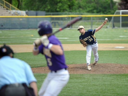 Penn Manor's Jeff Taylor delivers a pitch to Lancaster Catholicâ  s Bryan Downey. The Comets advanced with a 4-0 victory over the Crusaders at Ephrata War Memorial Field on Saturday, May 9, 2015. Patrick Blain for GameTimePA.com