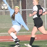 Stevenson's Kennedy Thurlow watches a shot bend toward the net during a game earlier this season.