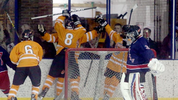 White Plains celebrates a goal by John Myers during the Guy Mathews Thanksgiving Invitational Hockey Tournament against Stepinac at the Ebersole Ice Rink in White Plains Nov. 25, 2017. The goal was Myers third of the game.