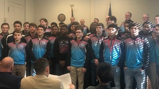 """Members of the Union County High School Wrestling team fill the fiscal court room on Tuesday as February 25th-March 3rd is declared """"Union County Wrestlers Week."""""""