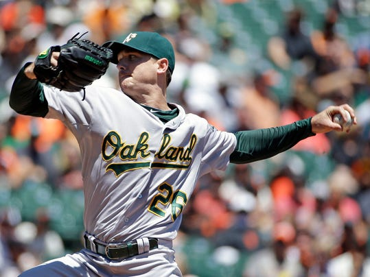 Oakland Athletics starting pitcher Scott Kazmir throws against the San Francisco Giants in the first inning of their interleague baseball game Thursday, July 10, 2014, in San Francisco. (AP Photo/Eric Risberg)