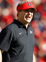 Georgia Bulldogs head coach Kirby Smart coaches during the second half of the spring game at Sanford Stadium.