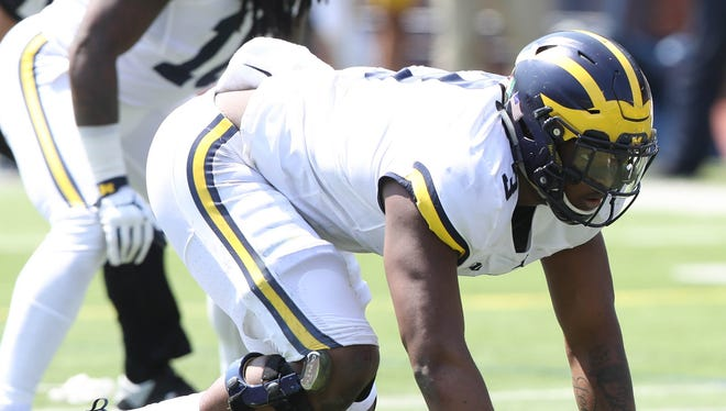 Michigan defensive end Rashan Gary sets up in the spring game Saturday, April 15, 2017 at Michigan Stadium in Ann Arbor.