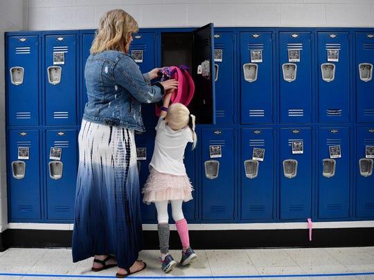 Kindergarten teacher Ashley Metzelaars helps her new student Teagan Ritter put away her backpack on the first day of school at Elzie D. Patton Elementary School in Wilson CountyWednesday Aug. 1, 2018, in Mt. Juliet, Tenn.