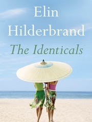 """This cover image released by Little, Brown and Company shows """"The Identicals,"""" by Elin Hilderbrand, available on June 13."""