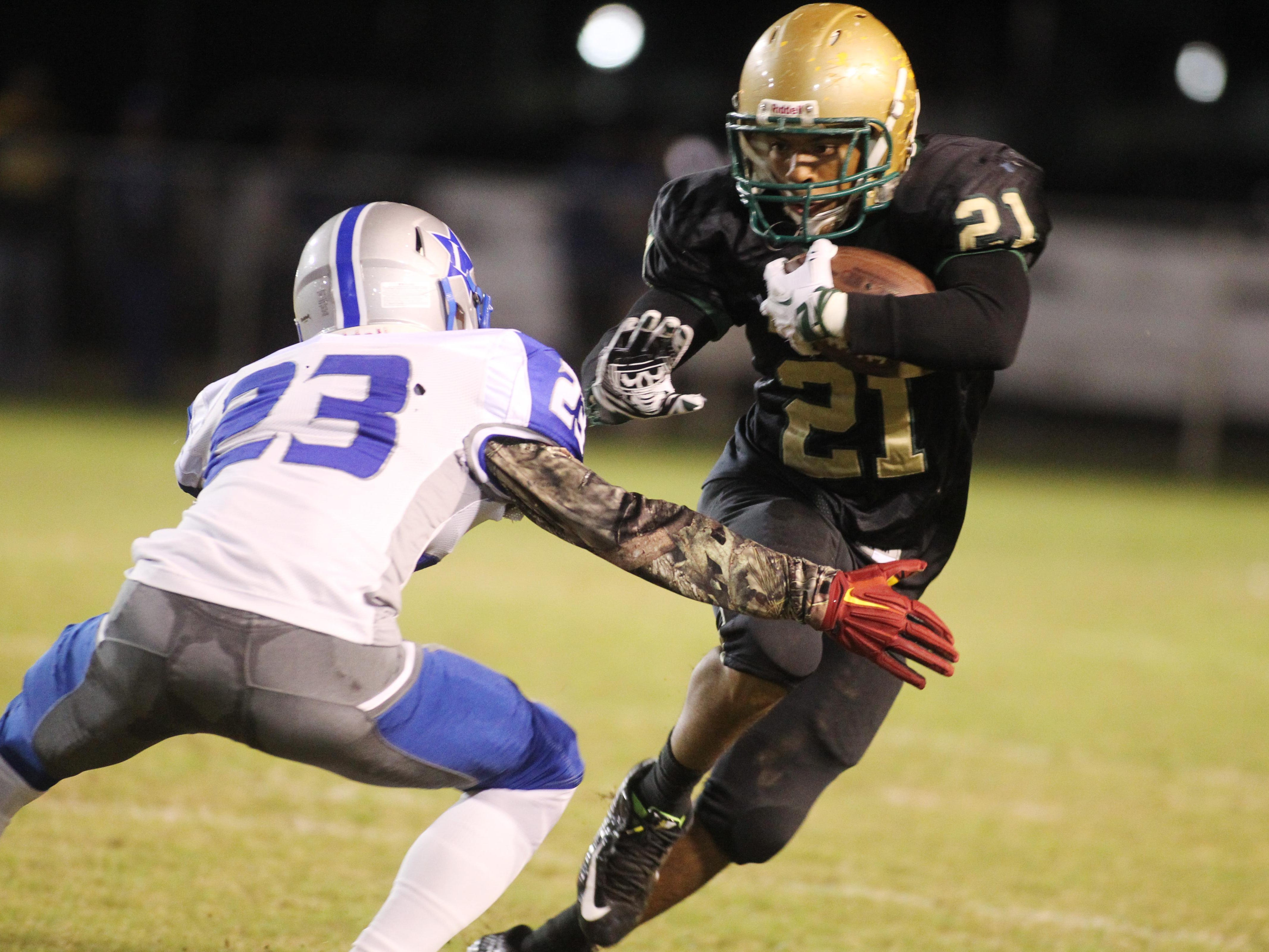 Lincoln running back Denzel Washington had a three-yard touchdown in the first half of Friday night's 44-41 overtime victory over Lee in the first round of the Class 7A playoffs.