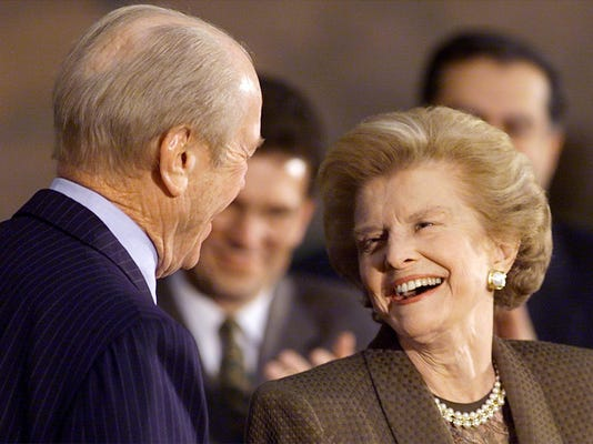 Former First Lady Betty Ford (R) looks at her husb