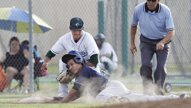 Redwood's Elijah Munoz tries to slide in safely but is tagged out at third base in last season's meeting against El Diamante. The Rangers and Miners open a home-and-away series starting Wednesday at Aaron Hill Field.