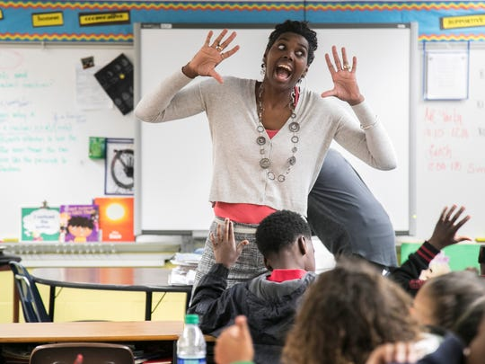 Tamara Joy Hunter gets the attention of her class at Franklin Park Magnet School on Wednesday while they were working on a project about Martin Luther King Jr.