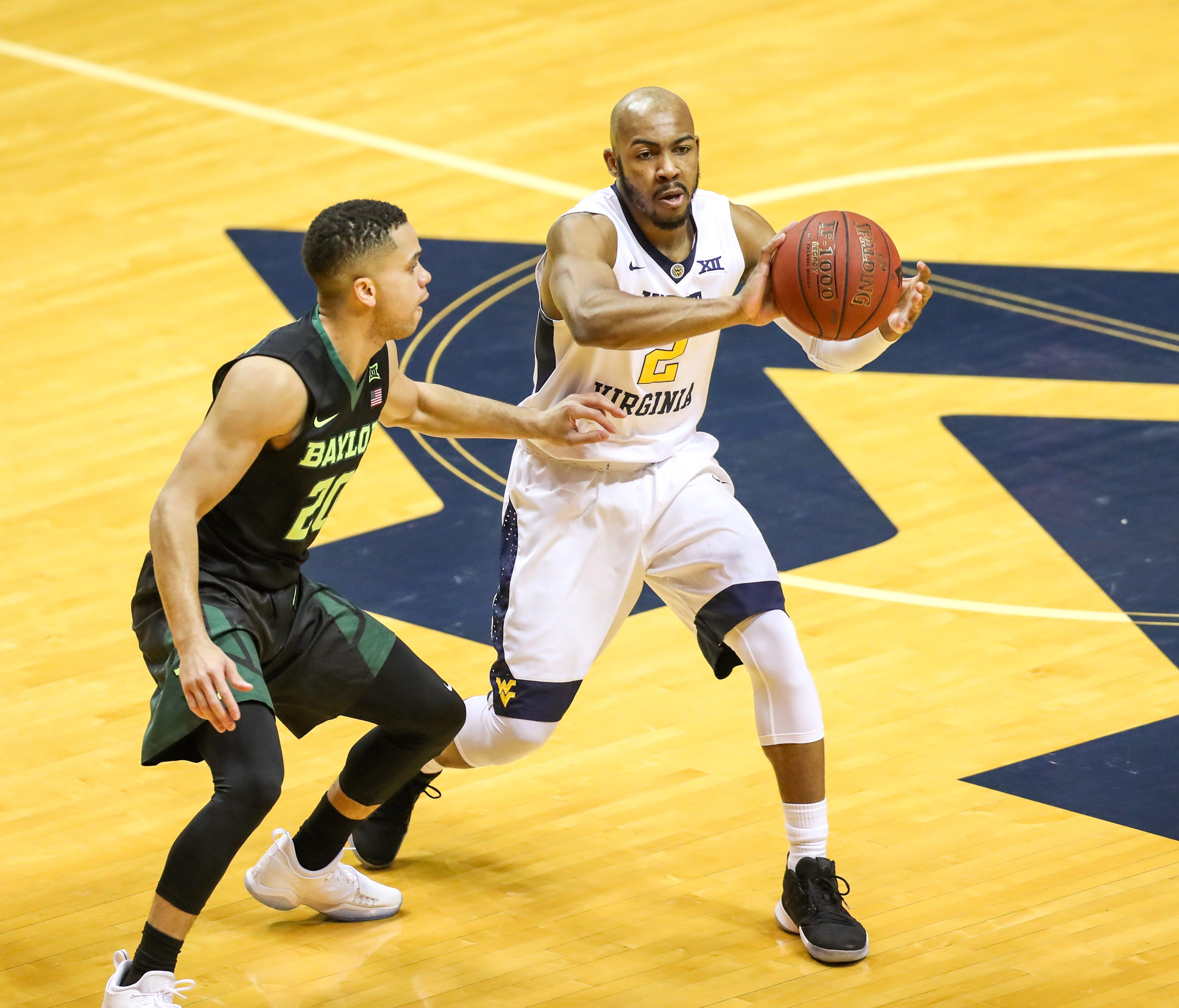 West Virginia guard Jevon Carter passes the ball during the first half against Baylor.
