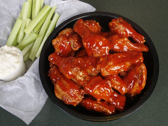 Chicken wings, celery, and bleu cheese dressing from