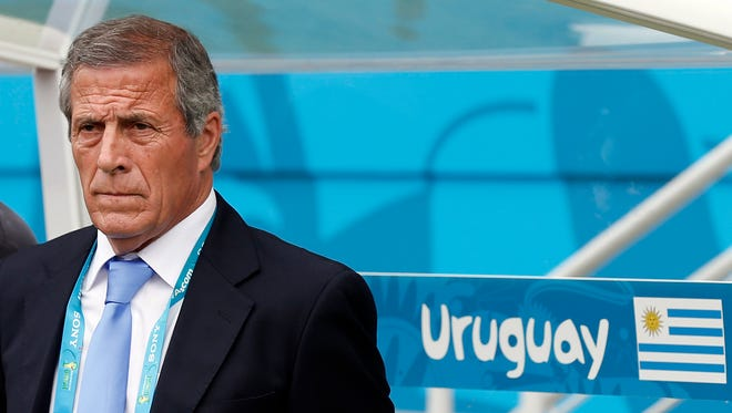 Uruguay manager Oscar Tabarez looks on before their game against Italy at Estadio das Dunas.