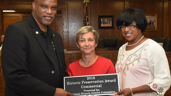 Rosemary St. Clergy accepts the 2018 Opelousas Historic District Preservationist Award for the restoration of a 91-year family home located at 119 West Vine Street. The award is presented annually to individuals who have restored or renovated structures in the city's historic district. The award was presented at Tuesday's Board of Aldermen meeting with Mayor Reggie Tatum (left) and alderwoman Sherelle Roberts.