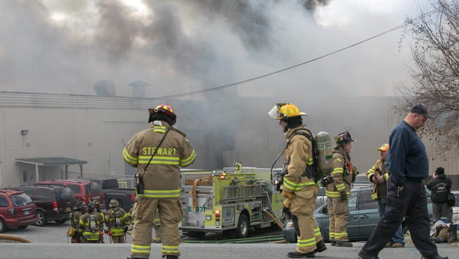 First responders battle a fire at Verla International cosmetics factory on Temple Hill Road in New Windsor on Monday, Nov. 20, 2017.