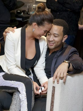 John Legend, right, and his model fiancee, Chrissy