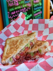 The Herman Muenster grilled cheese with bacon, guacamole and tomato from The Cheese Queen offered up during the Food Trucks at the Farm hosted by the Evansville Food Truck Association at Farm 57 every Wednesday, July 11, 2018.