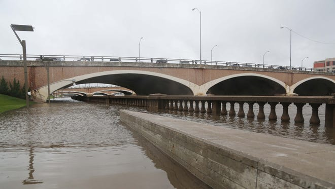 The Des Moines River has swelled from its banks as it flows through downtown Des Moines on June 15, 2015. Minor to moderate flooding has caused some trails and roads to close.