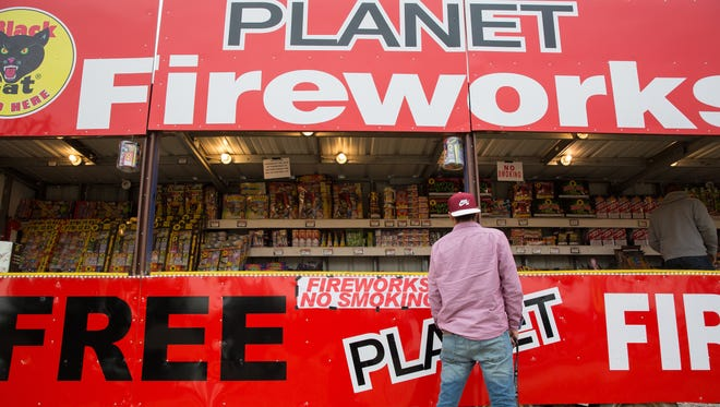 Ismael Felix, walks the length of Planet Fireworks in Mesilla on Avenida de Mesilla, Looking for fireworks, Friday December 30, 2016.