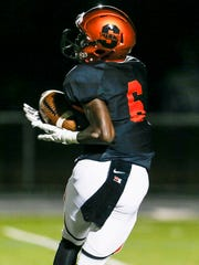 Somerville's Marcus Burnside (6) pulls in a touchdown pass in the second quarter against North Plainfield at Somerville on September 16, 2016.