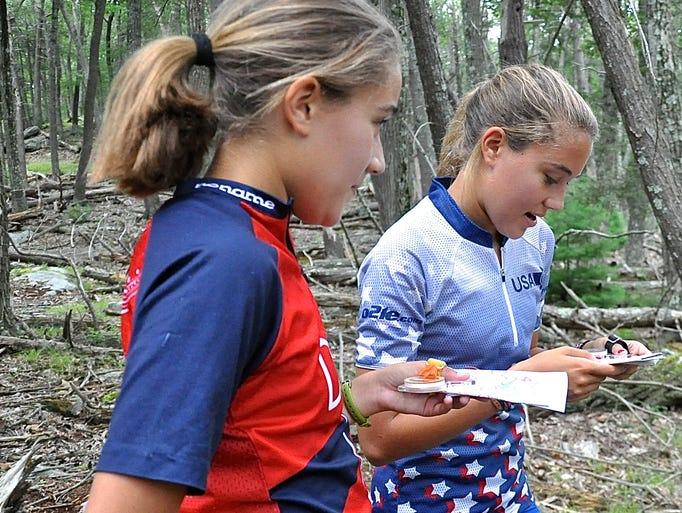Elina (l) and Anna Breton check map during Harriman orienteering practice.
