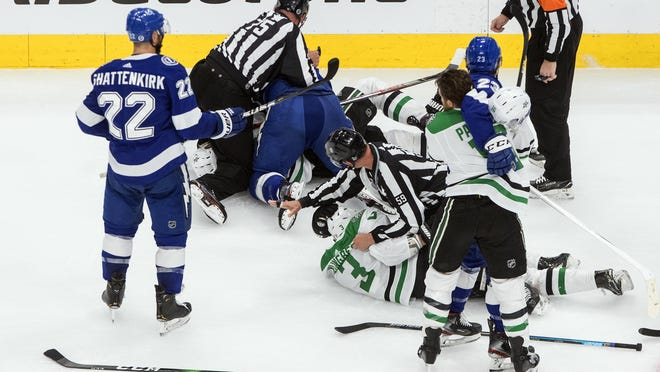 Dallas Stars and Tampa Bay Lightning players rough it up on Monday.
