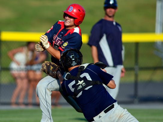 Dallastown's Eric Morrison is tagged out by Carlisle