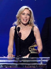Kim Campbell accepts a Grammy on behalf of her husband