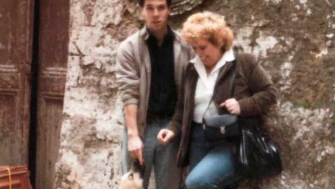Barbara Bowen and her son, Tim Turinsky, greet a four-legged friend during their 1986 travels in Greece.