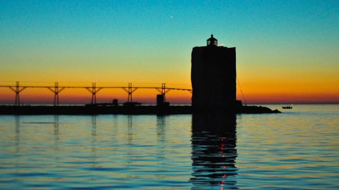 Algoma's Pierhead Lighthouse was cloaked for painting when this picture was taken at dawn Sept. 3.
