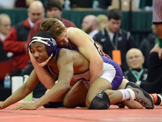 Freemont Ross's Lamonte Chapman wrestles Wadsworth's Noah Baughman during their Division I 120-pound championship match during the State High School Wrestling Tournament on Saturday at the Schottenstein Center in Columbus.