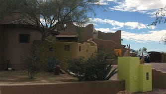 The Manjes' Santa Fe-style home sits on more than an acre in a county island just east of Mesa.