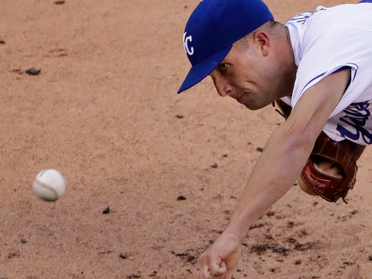 Kansas City Royals starting pitcher Danny Duffy throws during the second inning of a baseball game against the Oakland Athletics on Tuesday, Sept. 13, 2016, in Kansas City, Mo. (AP Photo/Charlie Riedel)