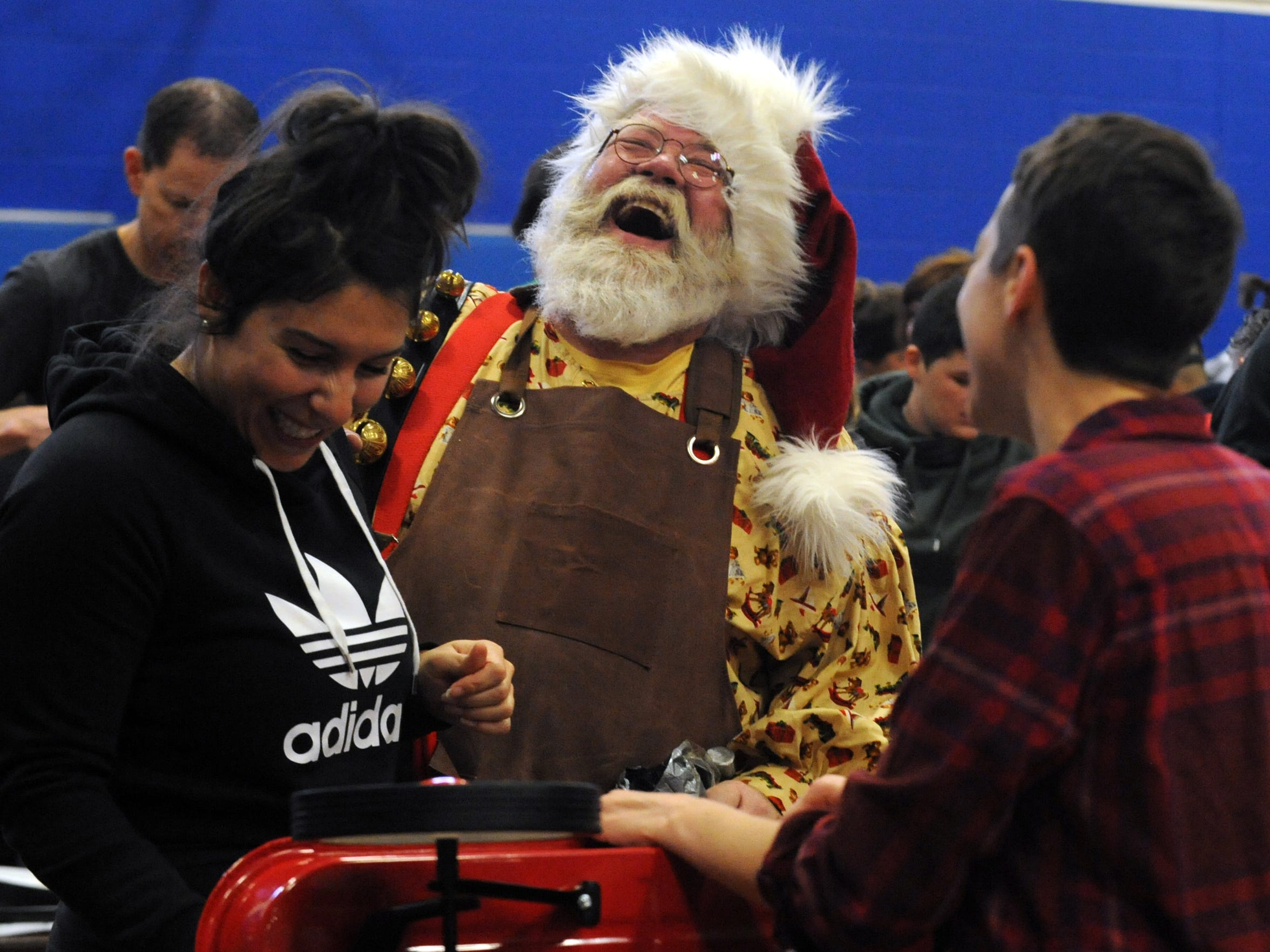 Tim Etienne laughs as he talks to volunteers Dec. 2, 2017, during the Wagons Ho Ho Ho build day at the Far East Community Recreation Center in Columbus. Tim was the charitable organization's official spokes Santa this year. The group is in its 10th year of building wagons and filling them with food for Christmas dinner to give to families in need throughout Central Ohio. More than 600 volunteers took part in this year's build day making 1,250 wagons. The group built 25 wagons its first year.