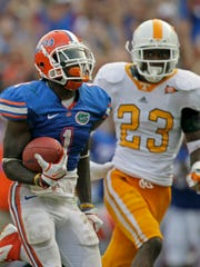 Florida running back Chris Rainey (1) runs past Tennessee defensive back Prentiss Waggner (23) on his way to an 83-yard touchdown on Sept. 17, 2011.