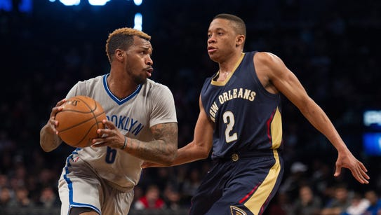 New Orleans Pelicans guard Tim Frazier (2) guards Brooklyn