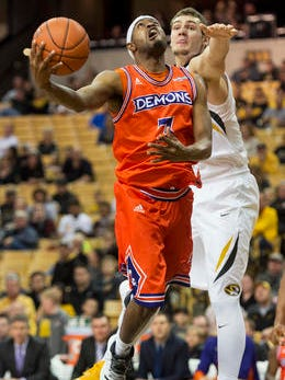 Northwestern State's Devonte Hall, left, shoots past Missouri's Reed Nikko, right, during the second half of an NCAA college basketball game Saturday.