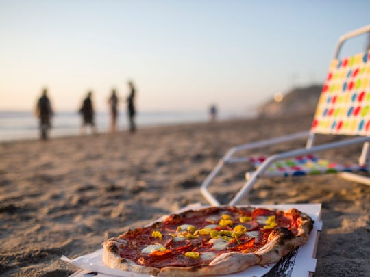 A pizza from URBN Pizza on the beach at Encinitas,
