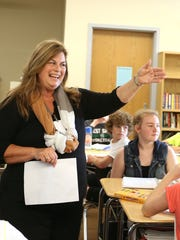 Val Luukinen, who was recently recognized as the Oregon Substitute Teacher of the Year, visits Marissa Miller's class on Wednesday, Sept. 23, 2015, at Straub Middle School in West Salem, Ore. Luukinen has worked as a substitute teacher in Miller's class.