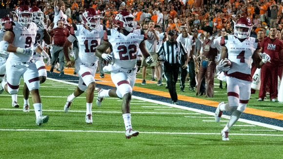 NMSU's DeMarcus Owens heads for the end zone after recovering a Miners fumble in the fourth quarter Saturday night at the Sun Bowl in El Paso.