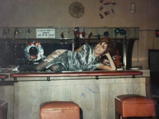 Carmen Ferguson is shown at her bar.