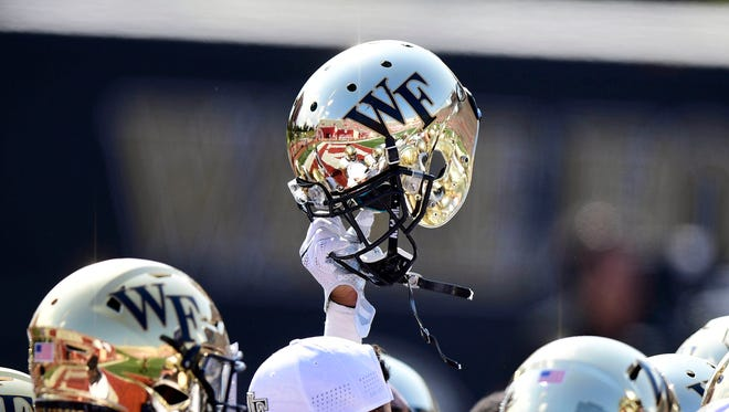 Memorial Stadium reflects in the helmet of a Wake Forest Demon Deacons.
