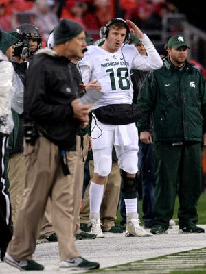MSU QB Connor Cook signals in plays during the Spartans' 17-14 win at Ohio State.