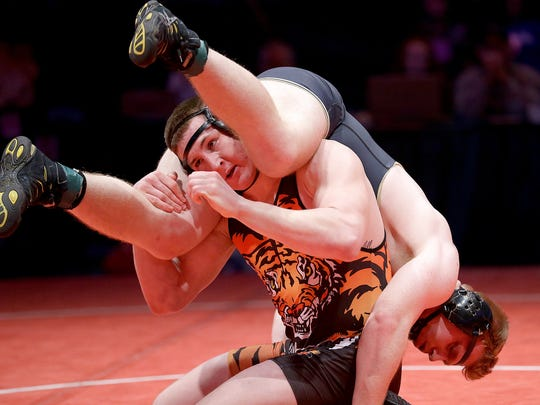 Lawrenceburg's Mason Parris,left, flips Daleville's Corbin Maddox,right, in  the 220-pound championship match at the IHSAA Wrestling State Finals Feb. 18, 2017, at Bankers Life Fieldhouse.