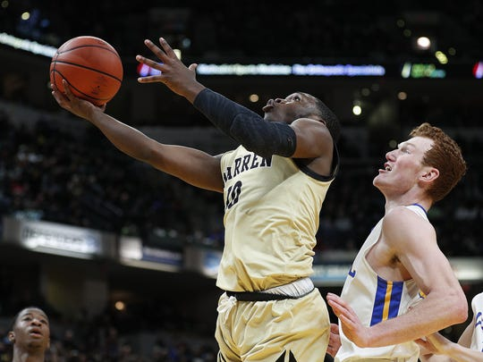 Warren Central Warriors Dean Tate (10) drives around Carmel Greyhounds John Michael Mulloy (33) during their IHSAA 4A boys basketball state finals game at Bankers Life Fieldhouse on Saturday, March 24, 2018.