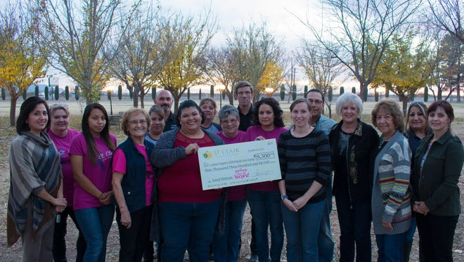 Pictured are St. Clair Winery Staff presenting this year's donation to the Cancer Support of Deming & Luna County, Patient Advocate Joanna Costilla and Board Members.