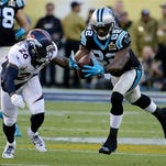 Carolina Panthers' Jerricho Cotchery (82) tries to catch a pass with Denver Broncos' Darian Stewart (26) defending during the first half of the NFL Super Bowl 50 football game Sunday, Feb. 7, 2016, in Santa Clara, Calif. (AP Photo/Gregory Bull)