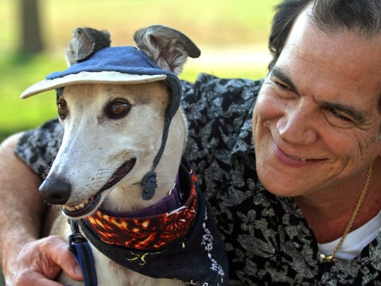 Dr. Anthony De Canto, of Branchburg, hugs his dog Buster,