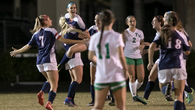 Estero celebrates a goal in the first half of action against Fort Myers in the 4A Regional Semifinals on Tuesday at Fort Myers High School.