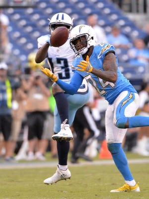 San Diego Chargers cornerback Brandon Flowers (24) intercepts a pass by Tennessee Titans quarterback Marcus Mariota (not pictured) and returns it for a touchdown during the second half at Qualcomm Stadium. San Diego won 43-35. Mandatory Credit: Orlando Ramirez-USA TODAY Sports