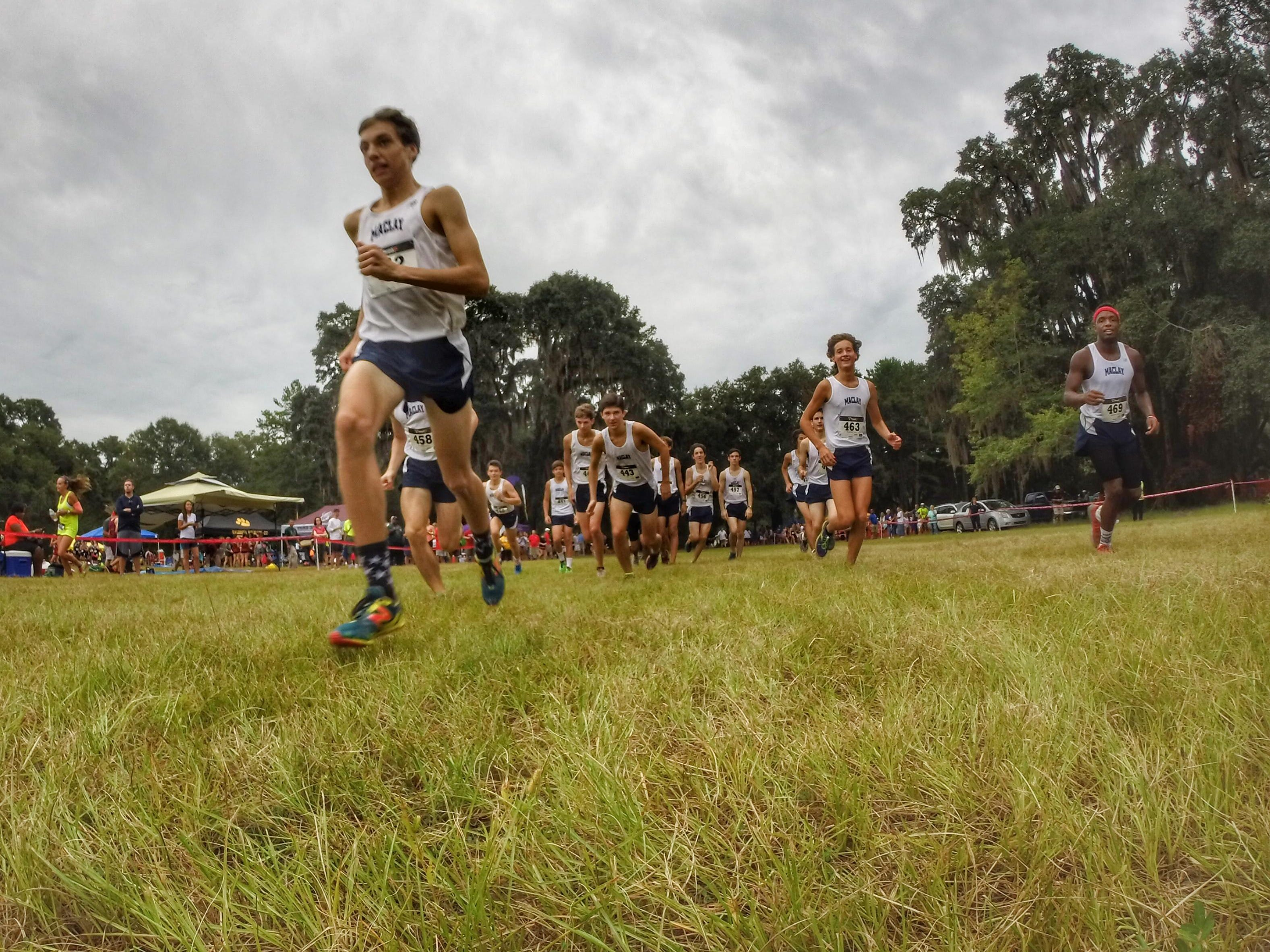 Maclay's George Gwynn warms up with the rest of his Marauders team behind him at the season-opening Cougar XC Challenge at Elinor Klapp-Phipps Park. Maclay is a favorite to win a 1A state title this season.